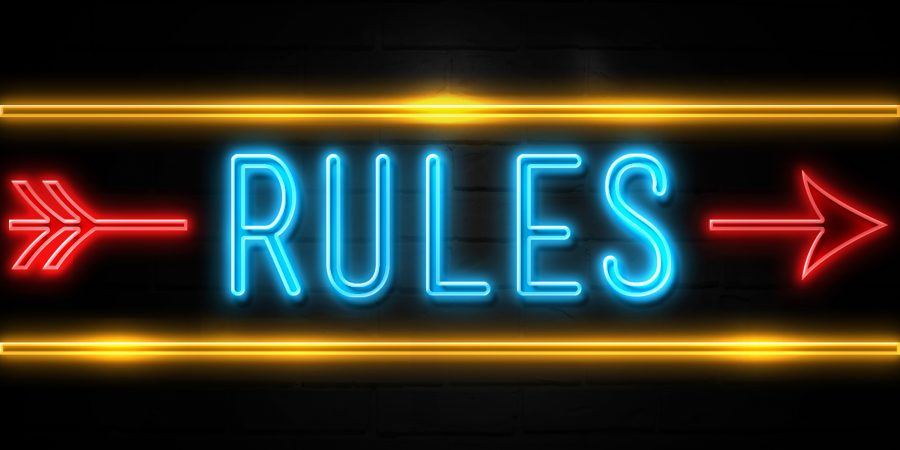 Rules  - fluorescent Neon Sign on brickwall Front view